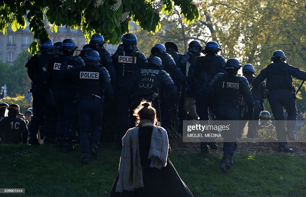 Riot police walk in a group during clashes with protesters at a traditional May Day demonstration on May 1, 2016, in Paris.