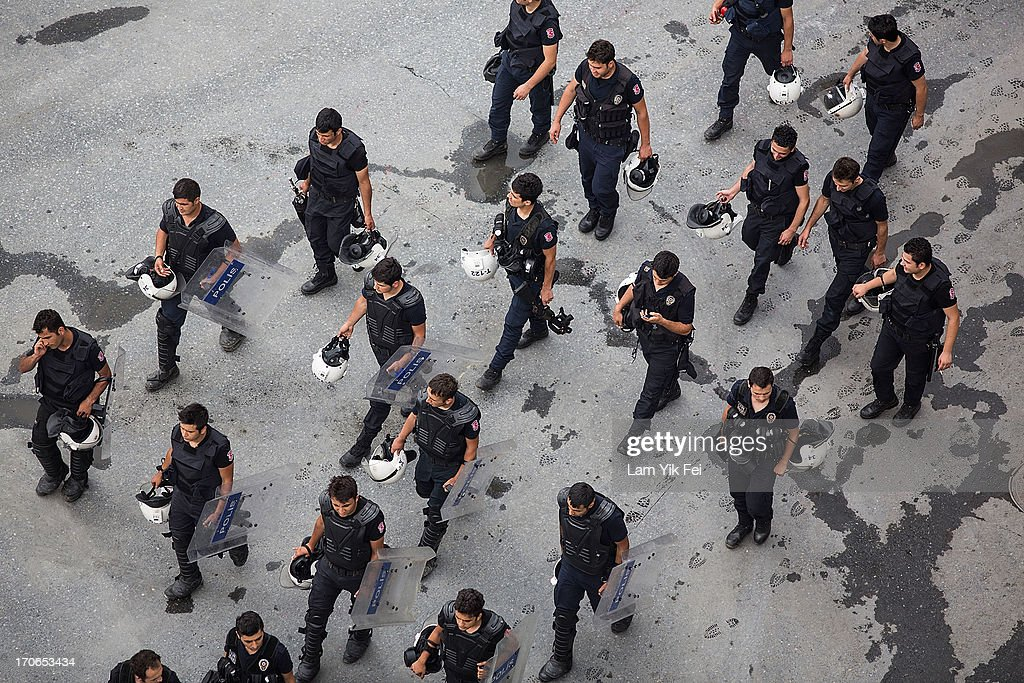 Riot police walk past Taksim Square after the crackdown action on June 16, 2013 in Istanbul, Turkey. Istanbul has seen protests rage on for days, with two protesters and one police officer killed. What began as a protest over the fate of Taksim Gezi Park turned into a wider demonstration over Prime Minister Recep Tayyip Erdogan's policies.