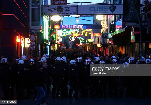 Riot police watch leftwing protesters during annual May Day demonstrations on May 1 2015 in Hamburg Germany In Germany May Day traditionally brings...