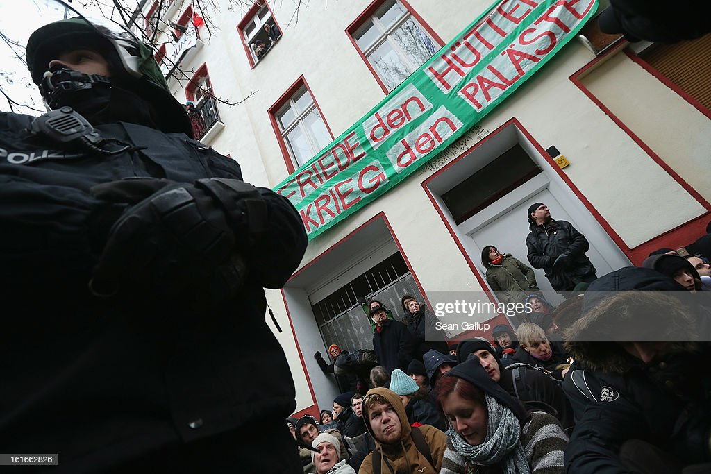 Riot police watch over protesters blockading the entrance to Lausitzer Strasse 8 to prevent the eviction of the German-Turkish Gulbol family on February 14, 2013 in Berlin, Germany. Several hundred protesters arrived to demonstrate in support of Ali Gulbol, his wife and two sons, who face eviction from their apartment in Kreuzberg district despite the fact that they invested EUR 20,000 into their apartment and have paid all their outstanding rent, albeit behind schedule. The case is highlighting an ongoing controversy over gentrification in parts of Berlin, where rising housing prices are luring investors and forcing long-standing tenants out.