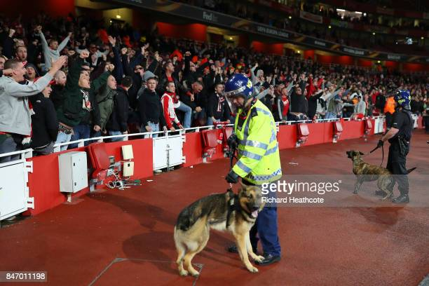 Riot police with dogs stand infront of the crowd ahead of the UEFA Europa League group H match between Arsenal FC and 1 FC Koeln at Emirates Stadium...