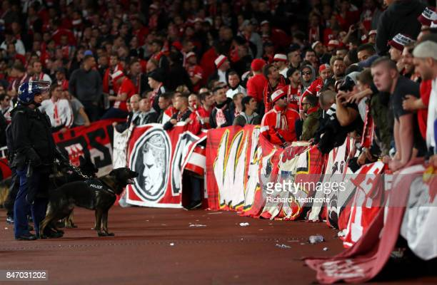 Riot police with dogs stand infront of the FC Koeln fans ahead of the UEFA Europa League group H match between Arsenal FC and 1 FC Koeln at Emirates...
