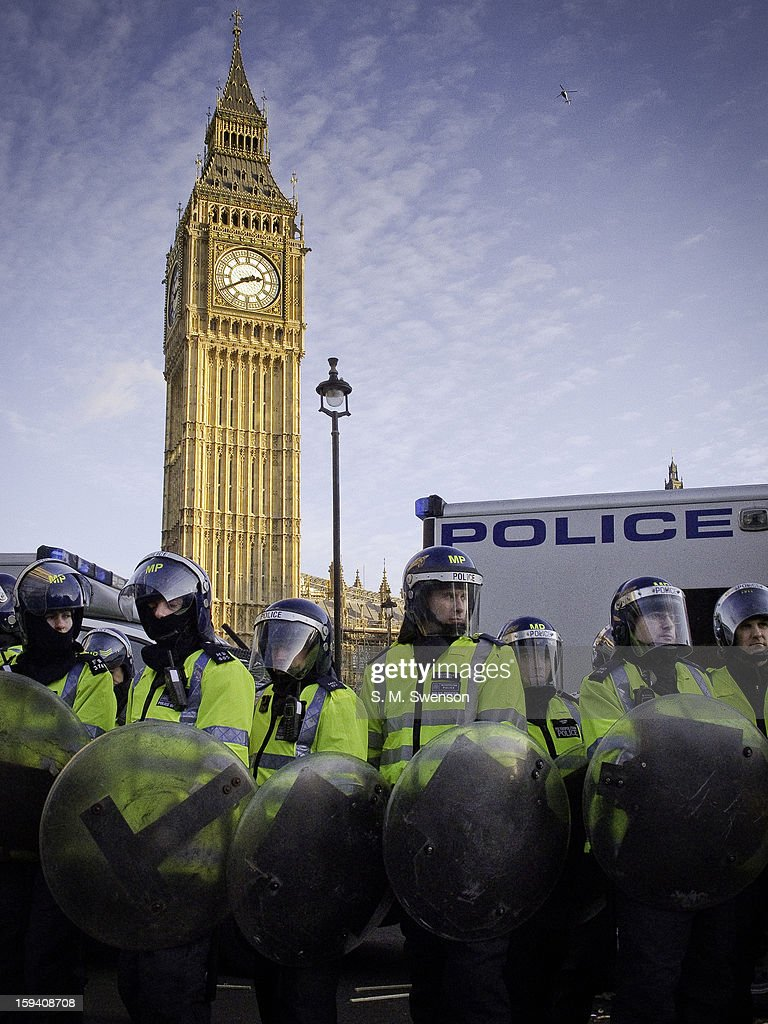 CONTENT] Riot Police with shields stand in front of Big Ben at a student demonstration that turned violent on December 9, 2010. The students were protesting the trebling of university fees. Taken in Westminster, Central London.