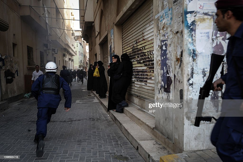 A riot policeman runs as protestors are being dispersed during a demonstration called for by the February 14 Youth Coalition, an Internet group that regularly calls for protests in the Shiite-majority kingdom on January 18, 2013 in the capital Manama. Bahrain's government said the demonstration had not been authorised and warned security forces would prevent it from going ahead. AFP PHOTO/MOHAMMED ALSHAIKH