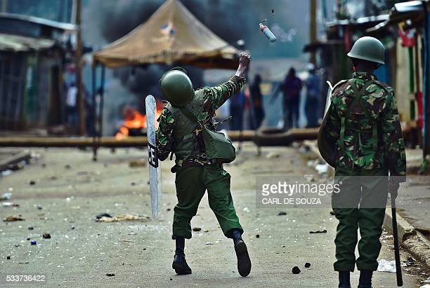 A riot policeman throws a teargas grenade at protestors during a demonstration of opposition supporters protesting for a change of leadership at the...