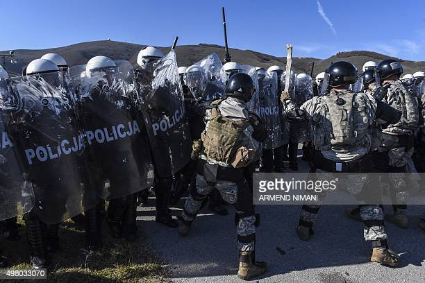 Riot policemen and US soldiers serving in the NATOled peacekeeping force take part in a crowd and riot control exercise near the village of Vrelo on...