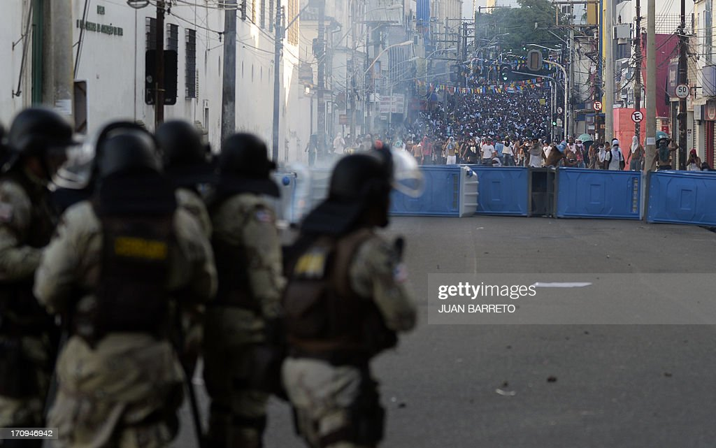Riot policemen approach protesters blocking an access to the Arena Fonte Nova Stadium in Salvador, Bahia --where Nigeria is to play Uruguay in a FIFA Confederations Cup Brazil 2013 football match-- during a protest of what is now called the 'Tropical Spring' against corruption and price hikes, on June 20, 2013. Brazilians took to the streets again Thursday in several cities on a new day of mass nationwide protests, demanding better public services and bemoaning massive spending to stage the World Cup. More than one million people have pledged via social media networks to march in 80 cities across Brazil, as the two-week-old protest movement -- the biggest seen in the South American country in 20 years -- showed no sign of abating.