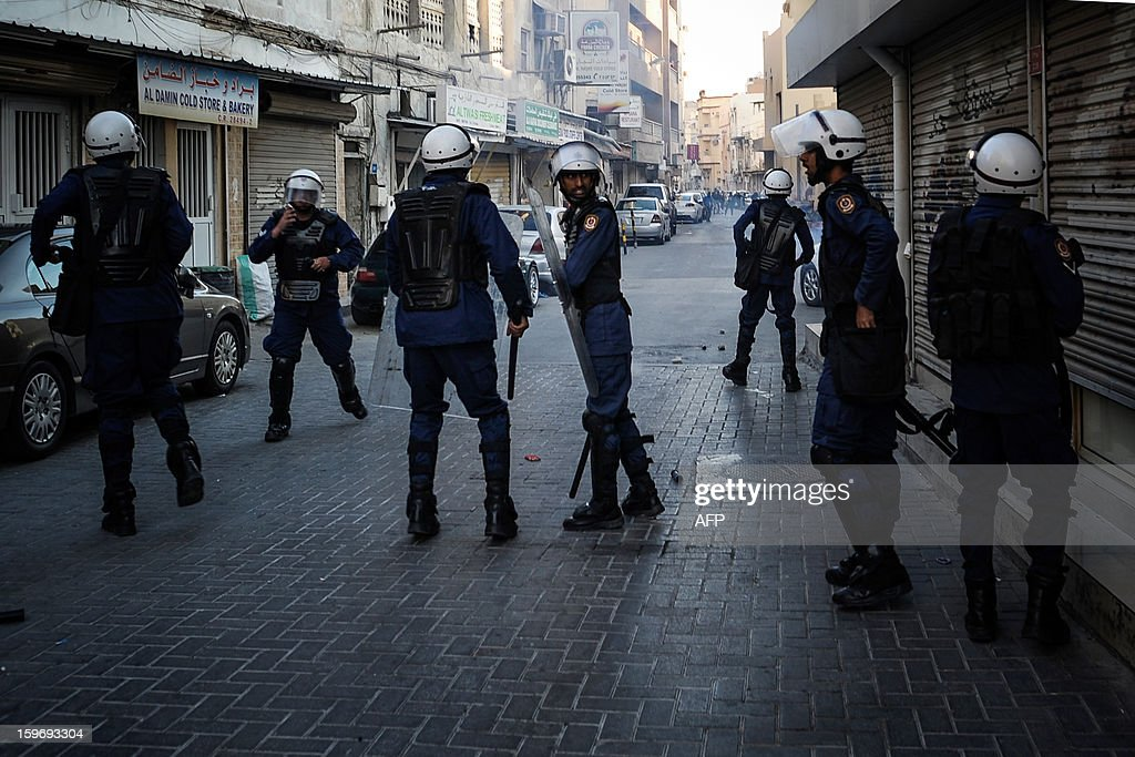 Riot policemen arrive to disperse protestors during a demonstration called for by the February 14 Youth Coalition, an Internet group that regularly calls for protests in the Shiite-majority kingdom on January 18, 2013 in the capital Manama. Bahrain's government said the demonstration had not been authorised and warned security forces would prevent it from going ahead.