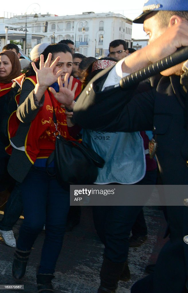 Riot policemen charge demonstrators during the celebration of the International Women's Day on March 8, 2013, in Rabat. The International Women's Day is marked on March 8 every year. AFP PHOTO/FADEL SENNA