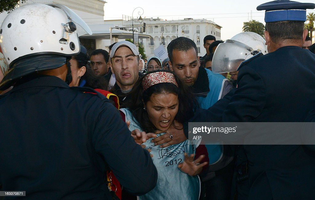 Riot policemen charge demonstrators during the celebration of the International Women's Day on March 8, 2013, in Rabat. The International Women's Day is marked on March 8 every year.