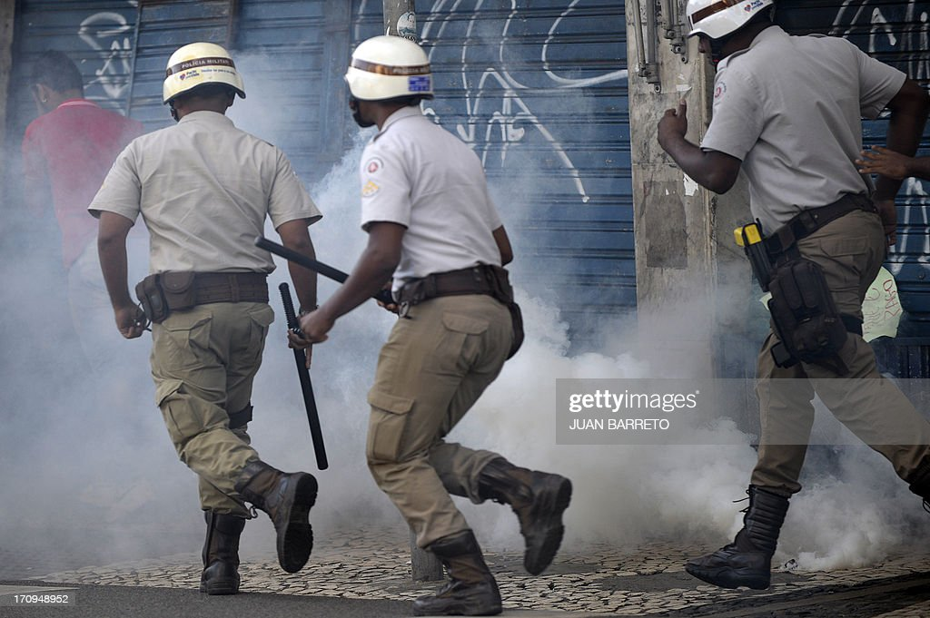 Riot policemen clash with protesters blocking an access to the Arena Fonte Nova Stadium in Salvador, Bahia --where Nigeria is to play Uruguay in a FIFA Confederations Cup Brazil 2013 football match-- during a protest of what is now called the 'Tropical Spring' against corruption and price hikes, on June 20, 2013. Brazilians took to the streets again Thursday in several cities on a new day of mass nationwide protests, demanding better public services and bemoaning massive spending to stage the World Cup. More than one million people have pledged via social media networks to march in 80 cities across Brazil, as the two-week-old protest movement -- the biggest seen in the South American country in 20 years -- showed no sign of abating.
