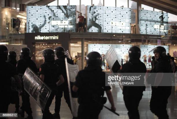 Riot policemen enter Termini station after protestors invaded the tracks and quays at the end of a demonstration against the upcoming G8 summit on...