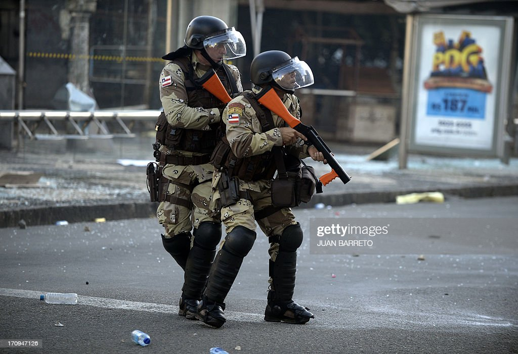 Riot policemen prepare to shoot tear gas to protesters blocking an access to the Arena Fonte Nova Stadium in Salvador, Bahia --where Nigeria is to play Uruguay in a FIFA Confederations Cup Brazil 2013 football match-- during a protest of what is now called the 'Tropical Spring' against corruption and price hikes, on June 20, 2013. Brazilians took to the streets again Thursday in several cities on a new day of mass nationwide protests, demanding better public services and bemoaning massive spending to stage the World Cup. More than one million people have pledged via social media networks to march in 80 cities across Brazil, as the two-week-old protest movement -- the biggest seen in the South American country in 20 years -- showed no sign of abating.