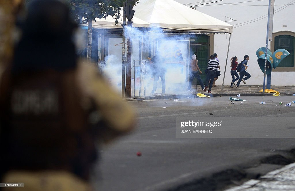 Riot policemen shoot tear gas to protesters blocking an access to the Arena Fonte Nova Stadium in Salvador, Bahia --where Nigeria is to play Uruguay in a FIFA Confederations Cup Brazil 2013 football match-- during a protest of what is now called the 'Tropical Spring' against corruption and price hikes, on June 20, 2013. Brazilians took to the streets again Thursday in several cities on a new day of mass nationwide protests, demanding better public services and bemoaning massive spending to stage the World Cup. More than one million people have pledged via social media networks to march in 80 cities across Brazil, as the two-week-old protest movement -- the biggest seen in the South American country in 20 years -- showed no sign of abating.