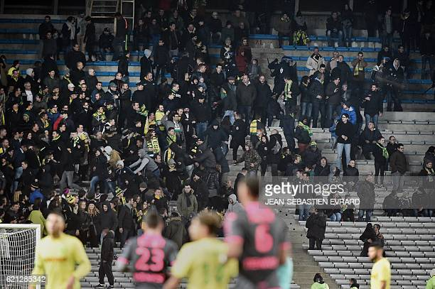 Riot policemen stop Nantes unhappy supporters trying to get into the president's box at the end of the French L1 football match between Nantes and...