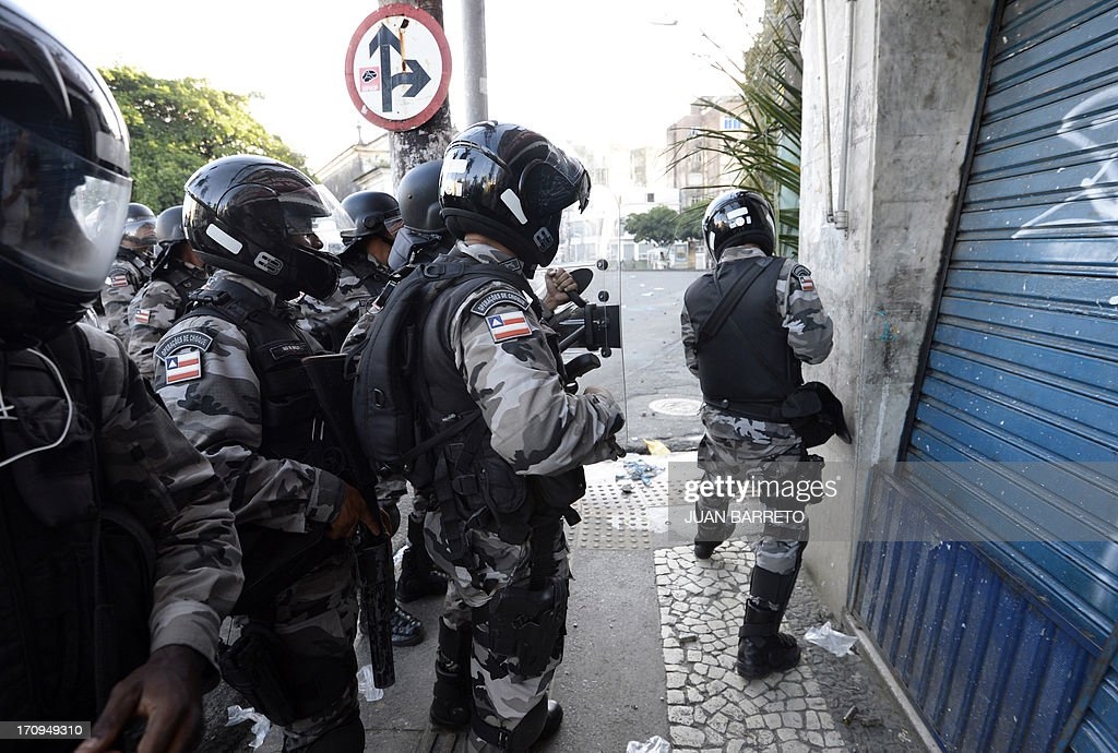 Riot policemen take their positions while protesters (out of frame) block an access to the Arena Fonte Nova Stadium in Salvador, Bahia --where Nigeria is to play Uruguay in a FIFA Confederations Cup Brazil 2013 football match-- during a protest of what is now called the 'Tropical Spring' against corruption and price hikes, on June 20, 2013. Brazilians took to the streets again Thursday in several cities on a new day of mass nationwide protests, demanding better public services and bemoaning massive spending to stage the World Cup. More than one million people have pledged via social media networks to march in 80 cities across Brazil, as the two-week-old protest movement -- the biggest seen in the South American country in 20 years -- showed no sign of abating.