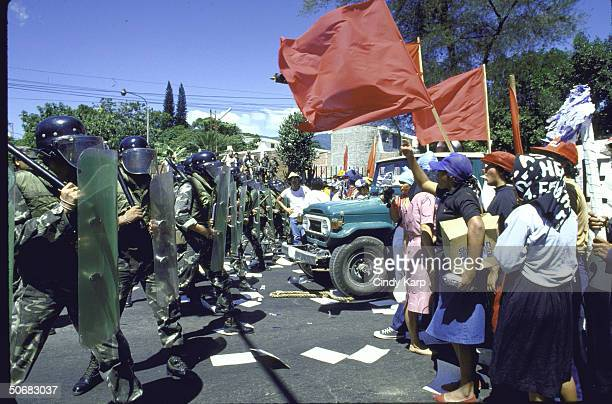 Riot squad facing off against students workers peasants who are protesting assassination of Human Rights Comm president Herbert Anaya Sanabria