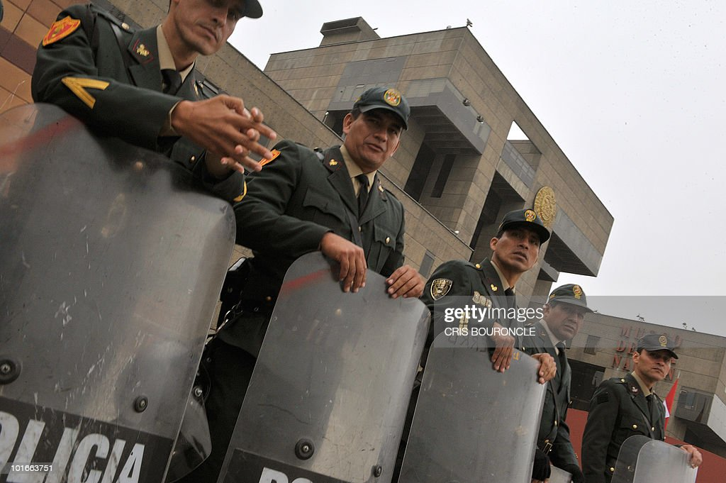 Riot squad officers stand guard outside the National Museum, hours before the inauguration of the 40th summit of foreign affairs ministers of the Organization of American States (OAS) in Lima on June 6, 2010. Ministers and representatives of the 33 member countries will meet for three days under the banner of 'Peace, Security and Cooperation of the Americas'.