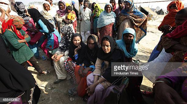 Riot victims and newlywed Muslim girls who were married in a mass wedding on October 25 at Malakpur camp pose on December 1 2013 in Shamli India An...