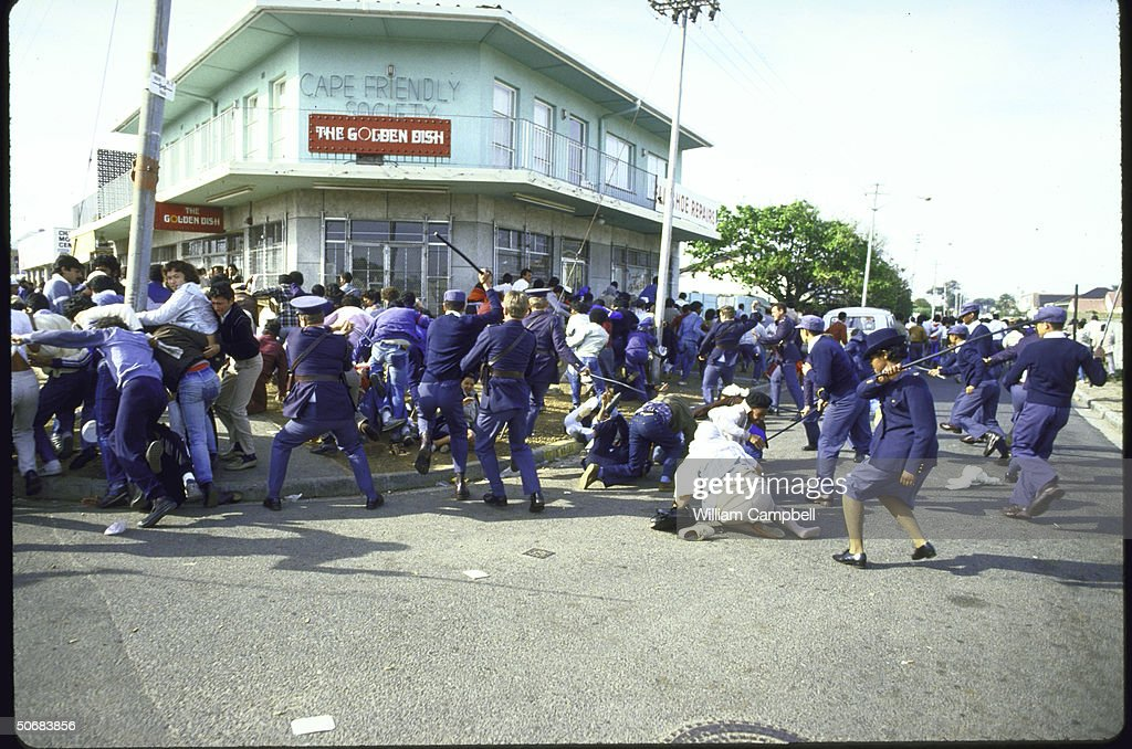 Riotcontrol police attack crowd of black protestors during antiapartheid demonstrations