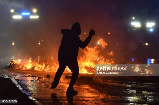 A rioter throws a stone on July 7 2017 in Hamburg northern Germany where leaders of the world's top economies gather for a G20 summit Protesters...