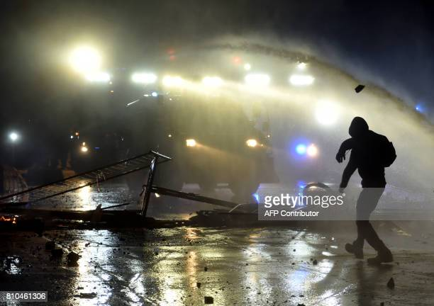 A rioter throws a stone on July 7 2017 in Hamburg northern Germany where leaders of the world's top economies gather for a G20 summit German police...