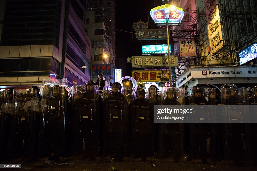Rioters clash with police in Mong Kok district of Hong Kong on February 9, 2016 in Hong Kong. More than 40 police officers and journalists have been injured after a riot with protesters on the first day of Chinese New Year celebrations.