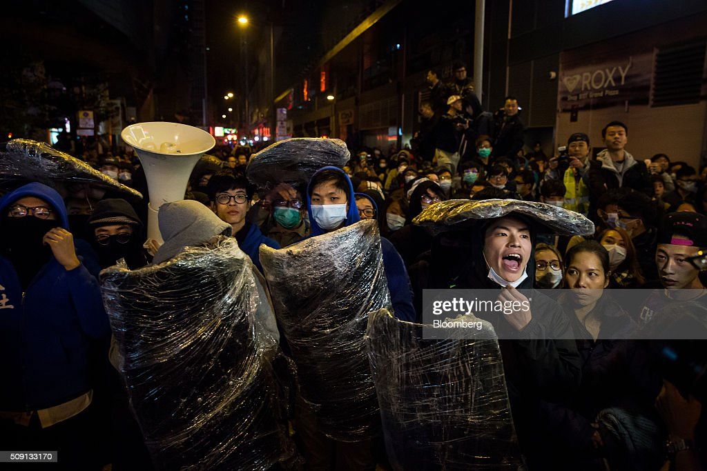 Rioters confront police in the Mong Kok area of Hong Kong, on Tuesday, Feb. 9, 2016. Rioters set fires and threw bricks at police in Hong Kong early Tuesday, injuring officers and shuttering one of the city's busiest subway stations in a clash over illegal food stalls during the three-day Chinese New Year holiday. Photographer: Billy H.C. Kwok/Bloomberg via Getty Images