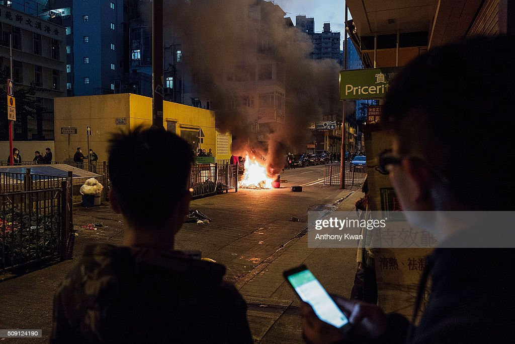 Rioters set fires in Mong Kok district of Hong Kong on February 9, 2016 in Hong Kong. More than 40 police officers and journalists have been injured after a riot with protesters on the first day of Chinese New Year celebrations.