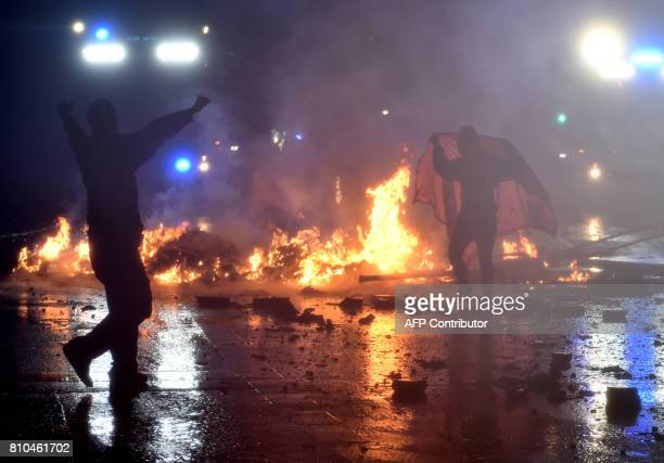Rioters stand in front of a barricade on July 7 2017 in Hamburg northern Germany where leaders of the world's top economies gather for a G20 summit...