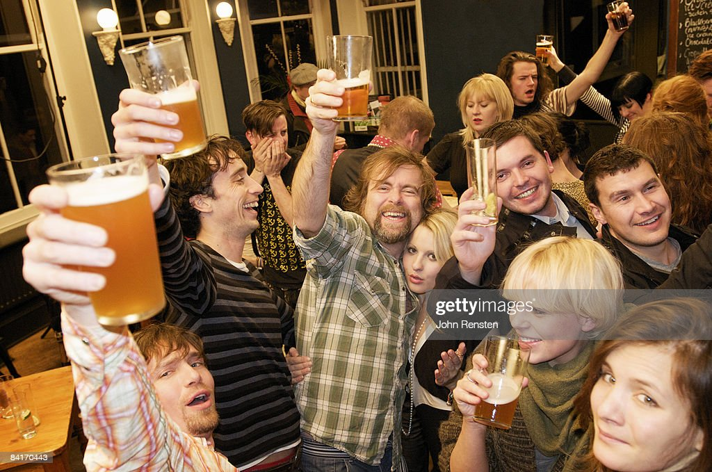 riotous drinking party in public bar  : Stock Photo