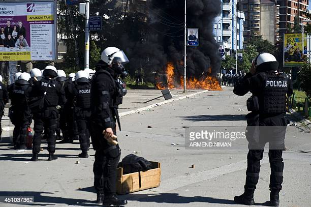Riotpolice prepare to fire tear gas grenades during clashes with protesters on June 22 2014 in the divided town of Mitrovica Kosovo police used tear...