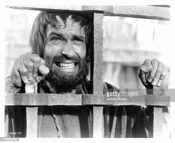 Rip Torn cringes as he hears the last of the whip as Jesus is prepared for the crucifixion in a scene from the film 'King Of Kings' 1961