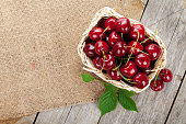 Ripe cherries on wooden table. View from above with copy space
