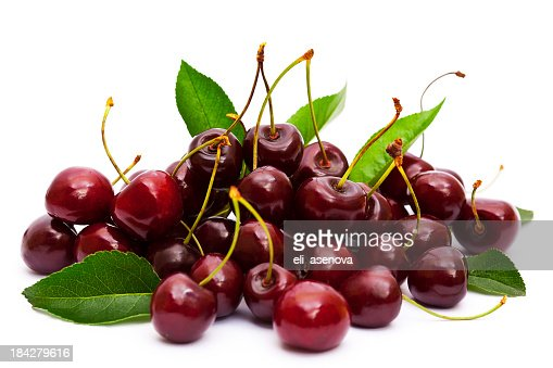 Ripe cherries with stalks and leaves on white background