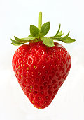 Ripe, organic strawberry on white background.