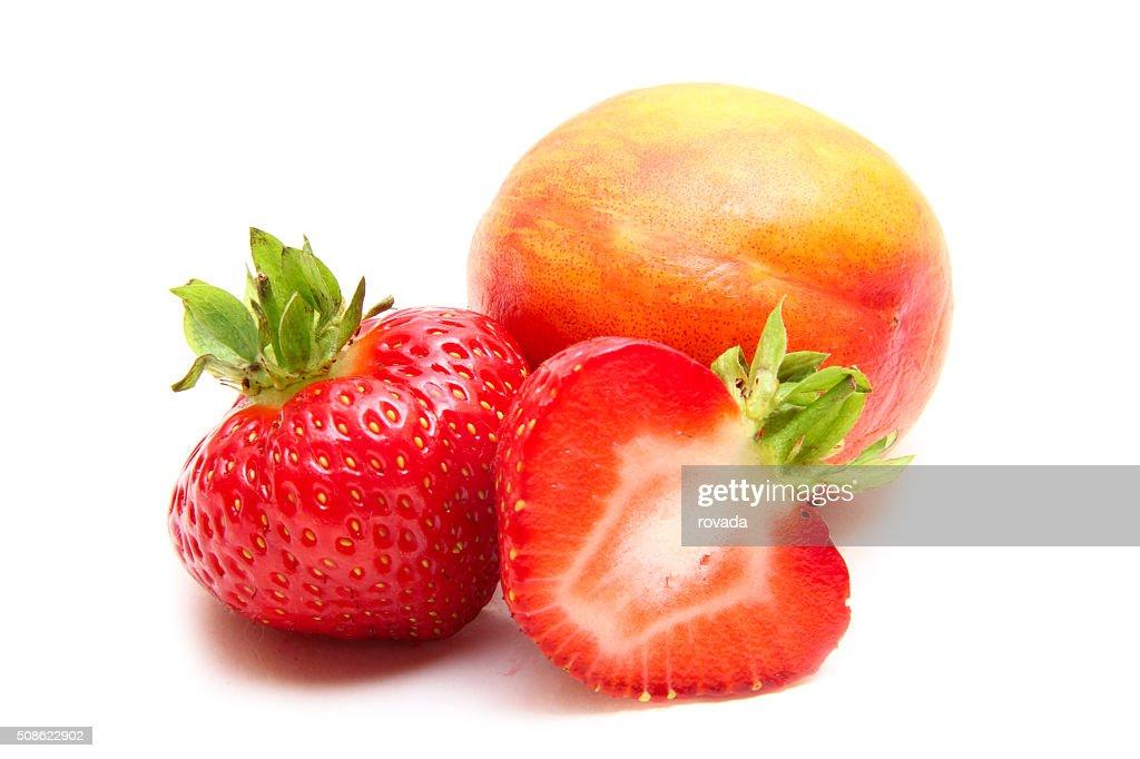 Ripe peaches ,strawberry on a white background : Stock Photo