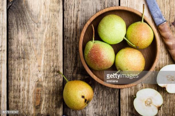 Ripe pears on rustic table