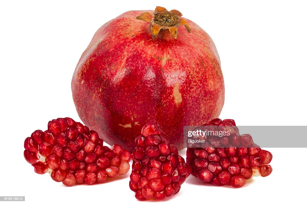 Ripe pomegranate fruit, isolated on white background : Bildbanksbilder