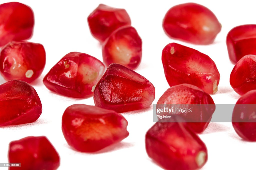 Ripe pomegranate seeds, isolated on white background : Stock Photo