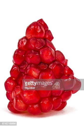 Ripe pomegranate seeds, isolated on white background : Stock Photo