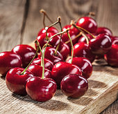 Ripe red cherries on old boards.