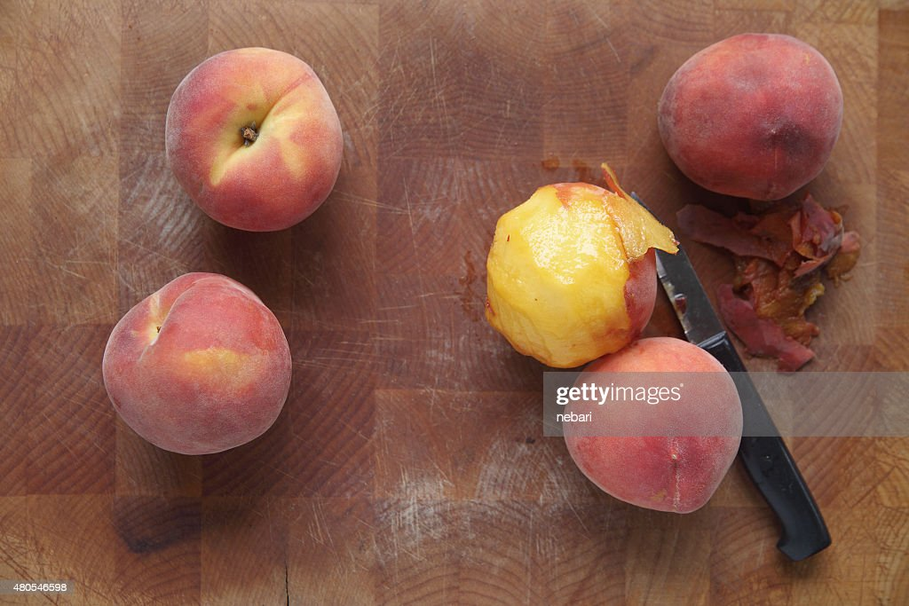 Ripe summer peaches, one peeled : Stock Photo