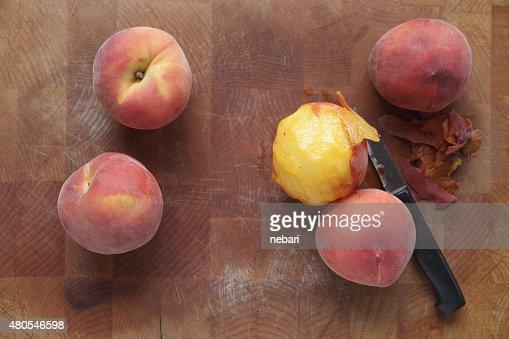 Ripe summer peaches, one peeled : Stock Photo
