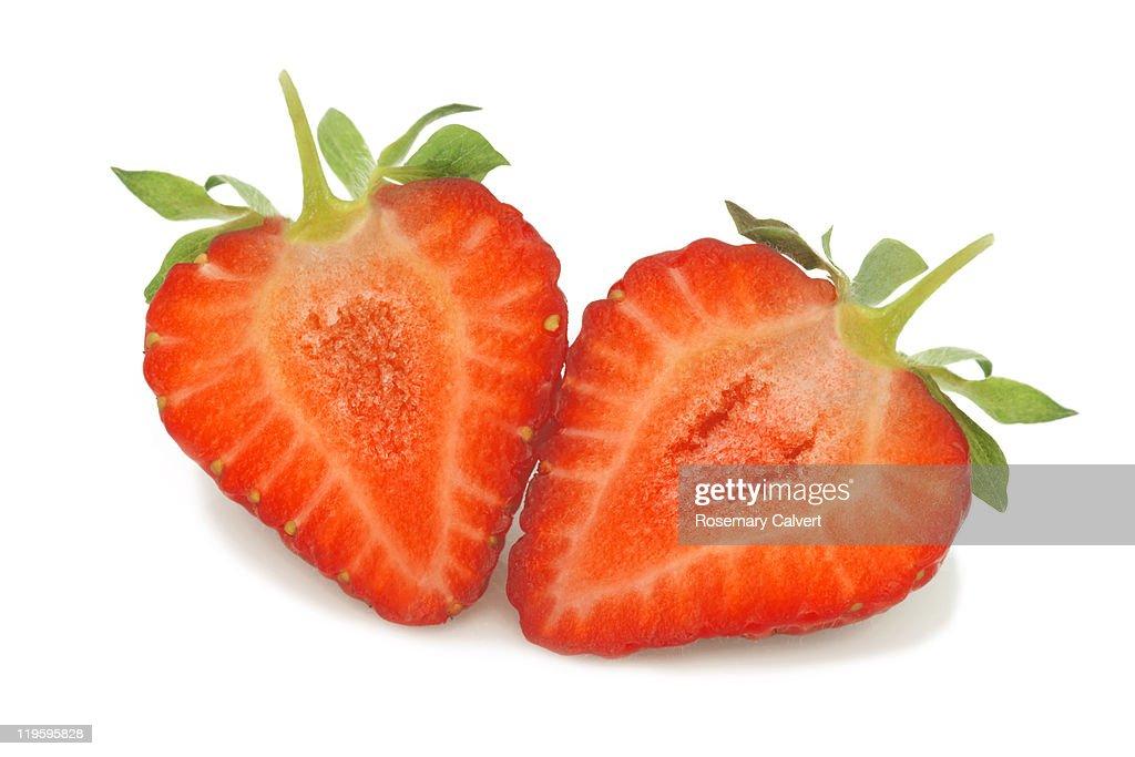 Ripe tasty strawberry cut into two halves : Stock Photo