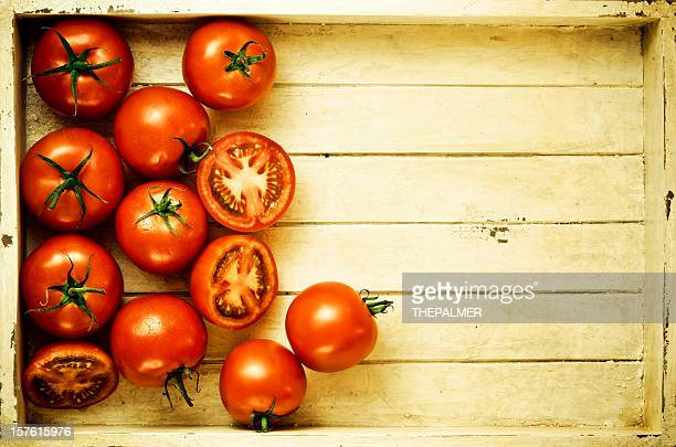 ripe tomatoes inside a vintage crate