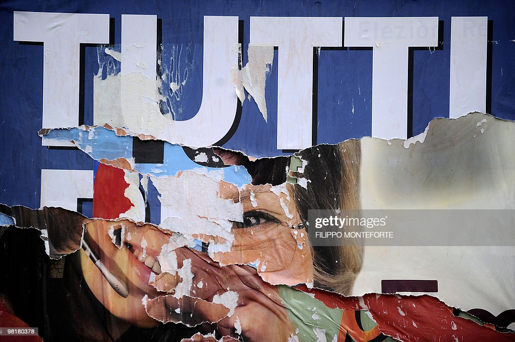 Ripped electoral banners reading 'Tutti' or all partially show the faces of the candidates in downtown Rome on March 27 2010 Two years after Silvio...