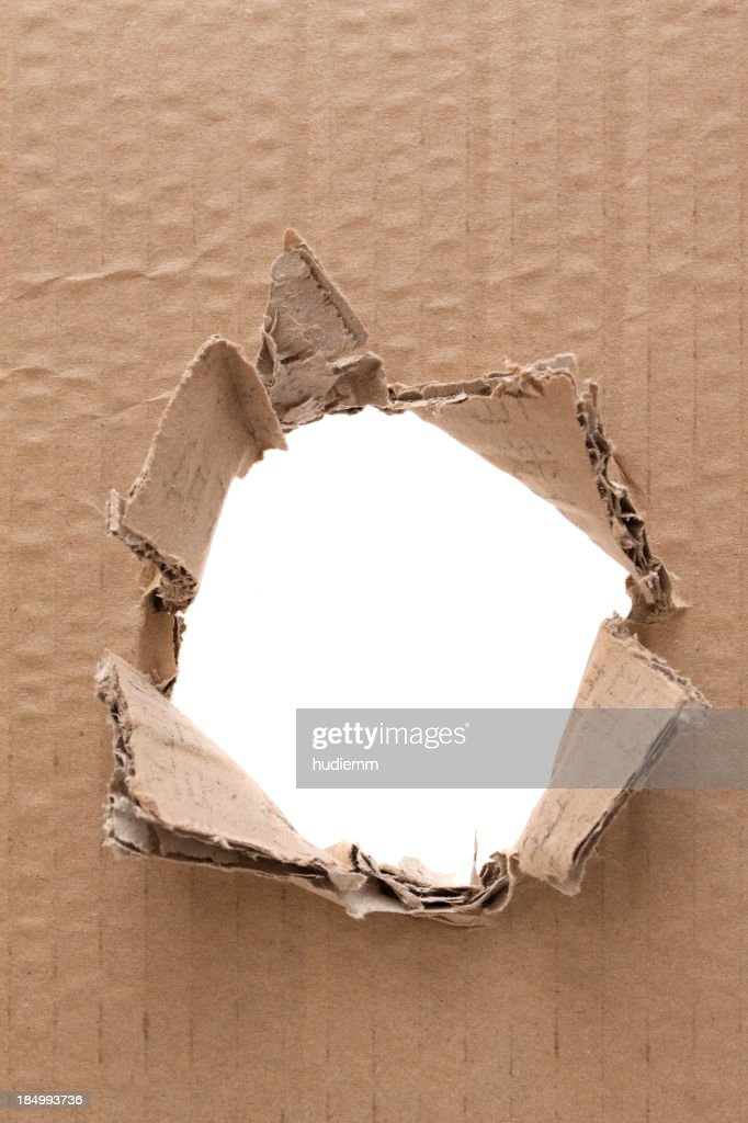 Ripped hole in cardboard