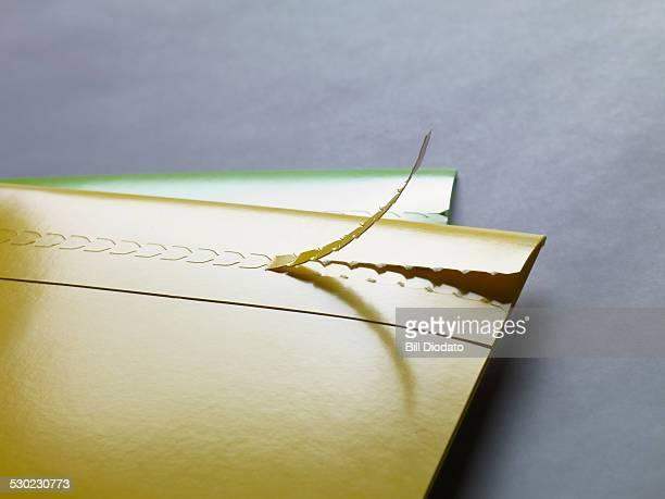 ripped open folder