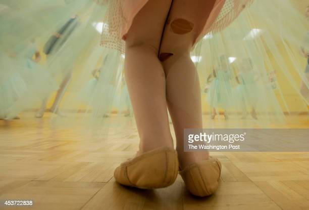 Ripped tights on a young active ballerina during summer camp at Ballet Petite on July 25 in McLean VA